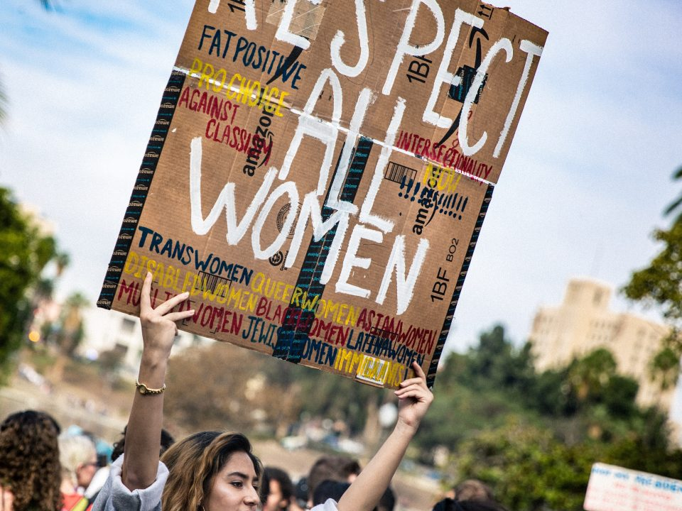 Women holding sign at protest